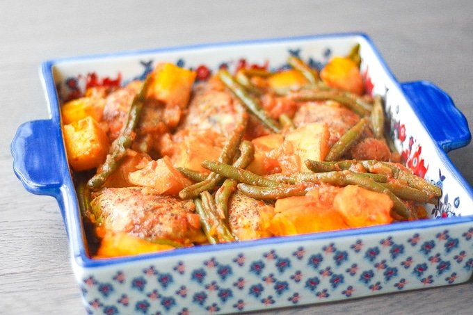 Chicken Thighs with Potatoes and Green Beans in Tomato Sauce: Budget-friendly chicekn thighs make for a delcious dinner packed with flavour in this Middle Eastern inspired dish | aheadofthyme.com