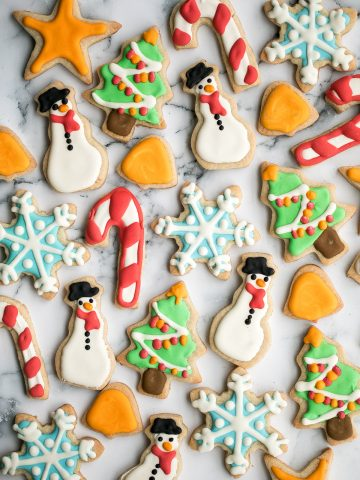 Christmas sugar cookies with royal icing are golden brown and crisp on the outside, but soft and tender inside. The best and festive gourmet holiday cookie.   aheadofthyme.com