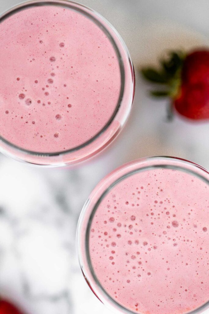 Quick and easy strawberry banana smoothie is the perfect breakfast on the go or refreshing snack. It's fruity, delicious, and packed with nutrients. | aheadofthyme.com