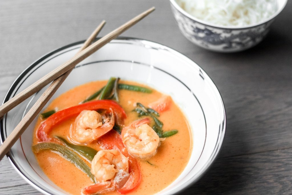 Better than takeout, Thai coconut red curry with prawns is easy, quick, and full of so much flavour! Cook this perfect weeknight dinner in just 15 minutes! | aheadofthyme.com