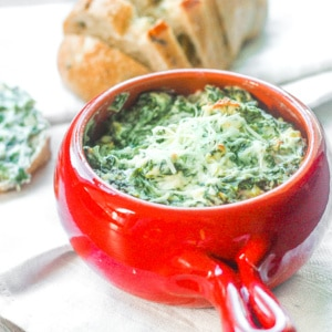 Baked Spinach Dip: This warm, rich and creamy spinach dip makes the perfect crowd-pleasing appetizer at your next party. Serve it on game day and it will be a hit! | aheadofthyme.com