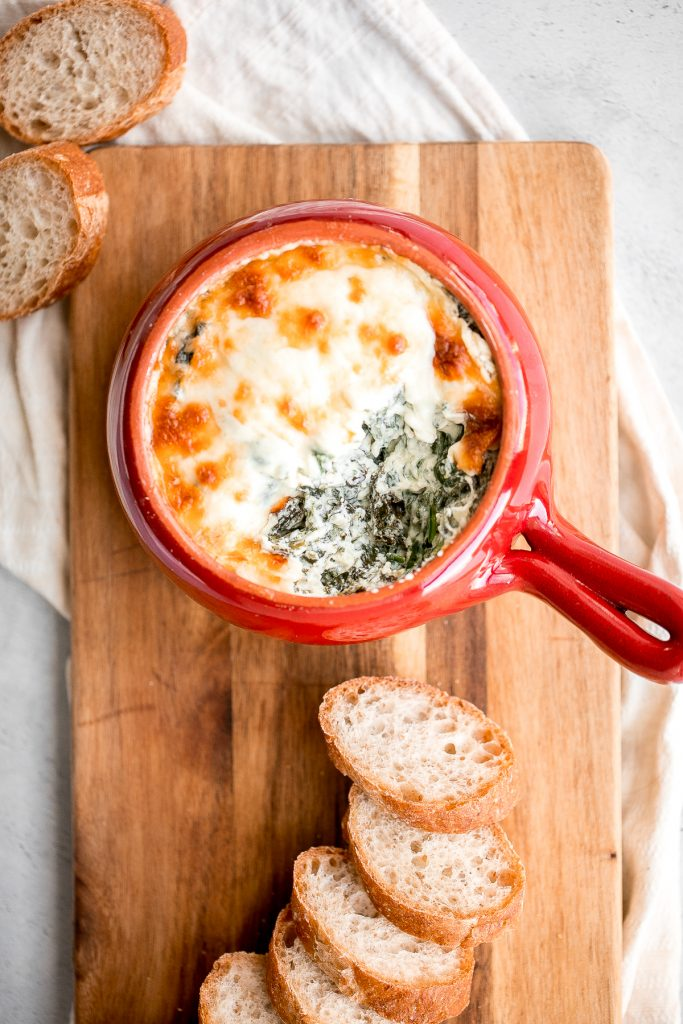 Warm, rich, creamy baked spinach dip is a delicious and easy appetizer that is baked until warm and melty. Easy to make ahead and a total crowd pleaser. | aheadofthyme.com