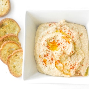 Classic Hummus: Make your own classic hummus in one simple step and witness the magic right before your eyes. This creamy and smooth dip is ideal as a healthy snack or appy | aheadofthyme.com