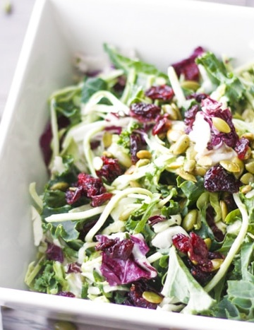 Kale Salad with Poppy Seed Dressing: Get your kale fix with this delicious kale salad with poppy seed dressing. Try this combination of crunchy greens, light poppy seed dressing, toasted pumpkin seeds and dried cranberries |aheadofthyme.com