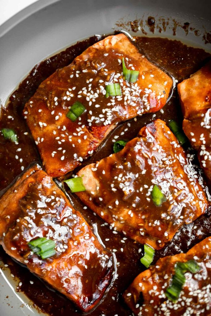Quick easy teriyaki salmon is tender, flaky, and flavorful, with bold flavors from the delicious teriyaki marinade. Great for dinner or meal prep lunches.   aheadofthyme.com