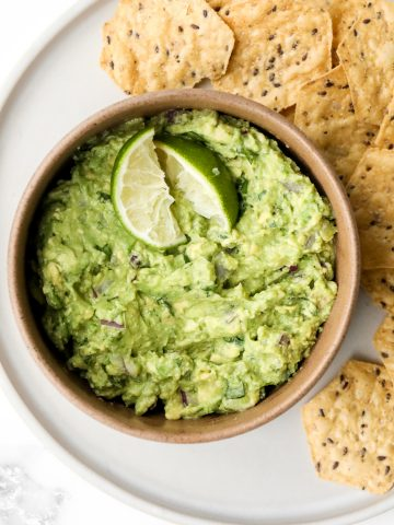 Delicious and easy guacamole is simple to make with just a few fresh ingredients in 5 minutes. This popular authentic Mexican dip is a total crowd-pleaser. | aheadofthyme.com
