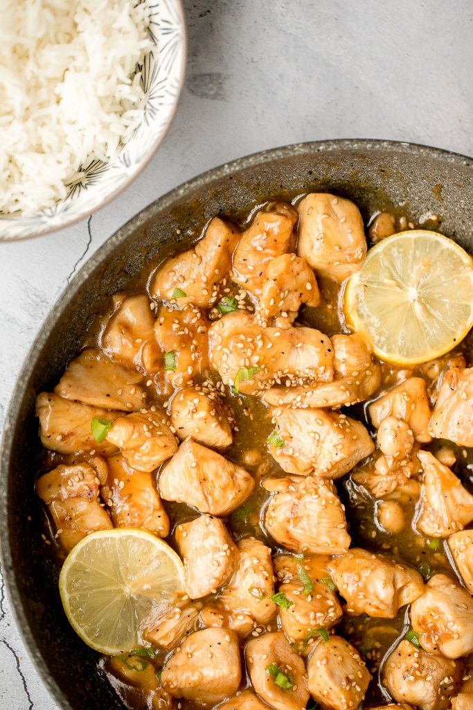 Better than takeout, healthy lemon chicken is a delicious, sticky chicken stir fry coated in a flavourful, sweet and tangy sauce. The best weeknight dinner. | aheadofthyme.com