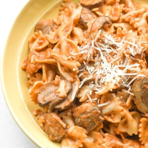 Farfalle Pasta with Light Creamy Mushroom Rosé Sauce: This heavenly combination of farfalle pasta, mushrooms and creamy rosé sauce makes up the best and creamiest Italian comfort food | aheadofthyme.com