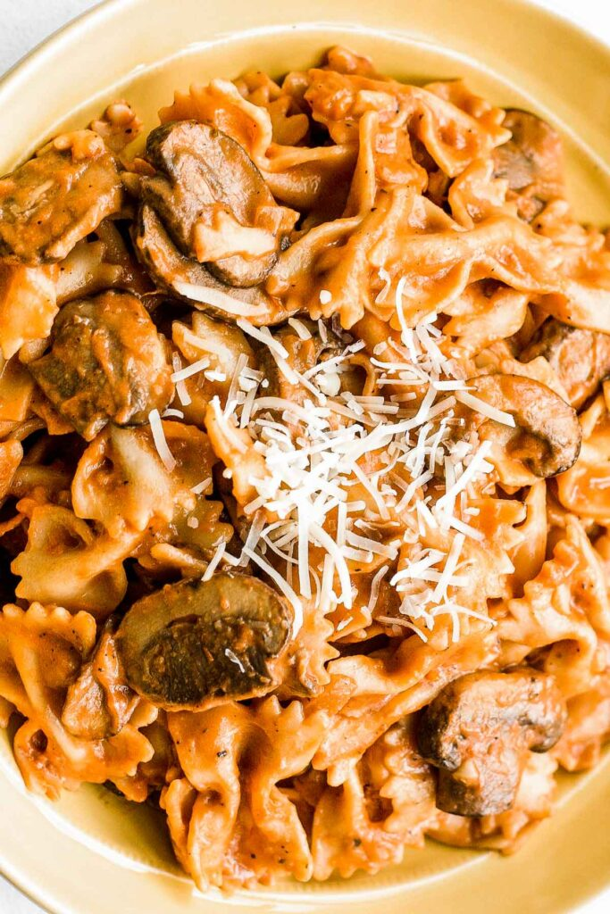 This heavenly combination of farfalle pasta, mushrooms and creamy rosé sauce makes up the best and creamiest Italian comfort food | aheadofthyme.com