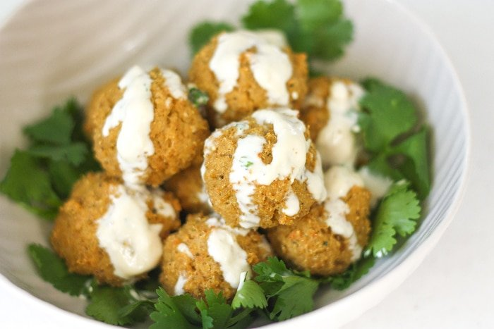 Quinoa, Cauliflower and Chickpea Vegetarian Meatballs with Tahini Sauce: Vegetarian meatballs are easy to make with a combination of quinoa, cauliflower, chickpeas and an assortment of spices and herbs, drizzled with a homemade tahini sauce | aheadofthyme.com