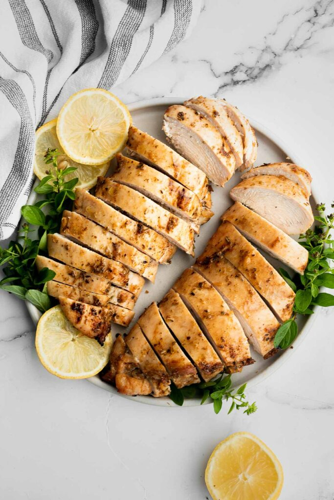 Juicy, tender, and moist, baked chicken breast with the best Greek souvlaki marinade is the most flavorful and delicious chicken dinner in under 30 minutes.   aheadofthyme.com