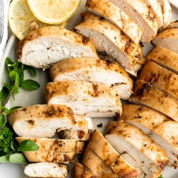 Juicy, tender, and moist, baked chicken breast with the best Greek souvlaki marinade is the most flavorful and delicious chicken dinner in under 30 minutes. | aheadofthyme.com
