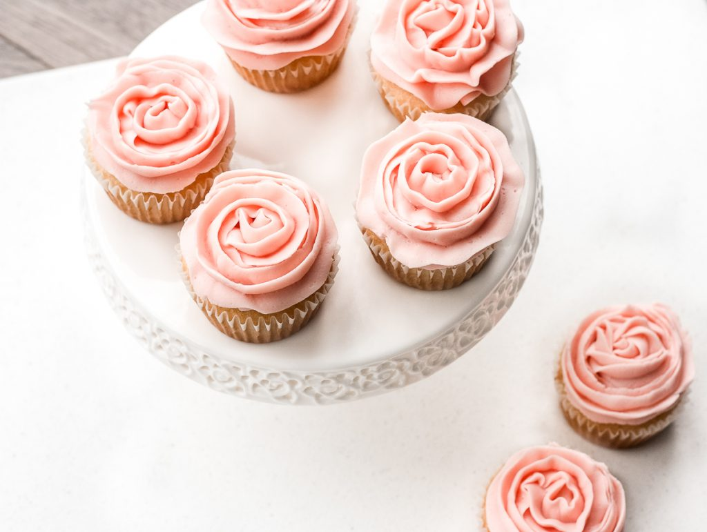Light, airy and fluffy vanilla cupcakes with rose petal buttercream icing is the cutest treat for Mother's Day. They are super quick and easy to make. | aheadofthyme.com