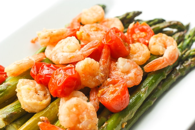 Light, fresh and vibrant, roasted lemon garlic shrimp and asparagus is the perfect dish for the spring and upcoming summer season | aheadofthyme.com