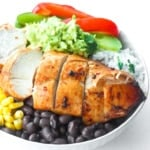 Chipotle Chicken Burrito Bowl with Easy Lime Cilantro Rice: Baked, tender, chipotle-flavoured chicken breasts sliced over a bowl of lime cilantro rice, corn, black beans and sauteed onions and bell peppers | aheadofthyme.com
