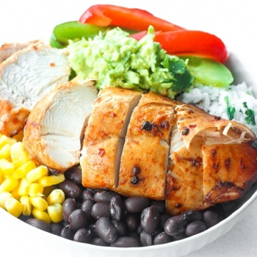 Chipotle Chicken Burrito Bowl with Easy Lime Cilantro Rice: Baked, tender, chipotle-flavoured chicken breasts sliced over a bowl of lime cilantro rice, corn, black beans and sauteed onions and bell peppers   aheadofthyme.com