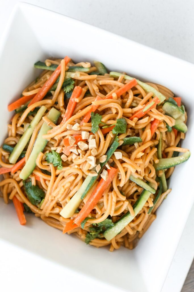 Nothing screams summer more than a crispy, crunchy, Asian cold noodle salad infused with a refreshing peanut, cilantro and lime dressing. | aheadofthyme.com