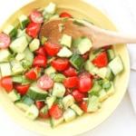 Simple Tomato Cucumber and Avocado Salad: Craving something light and refreshing? Try this simple tomato, cucumber and avocado salad, topped with cilantro, sunflower seeds and a lemon vinaigrette | aheadofthyme.com