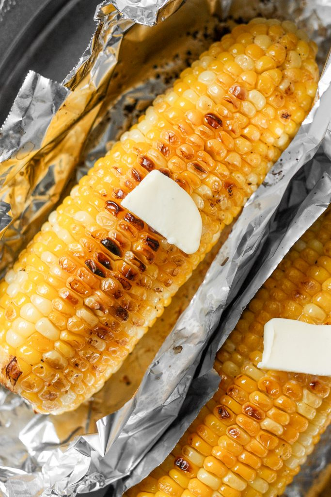 When it is inconvenient to grill your corn on the cob, try buttery, oven-roasted corn on the cob with garlic butter with beautiful char marks instead. | aheadofthyme.com