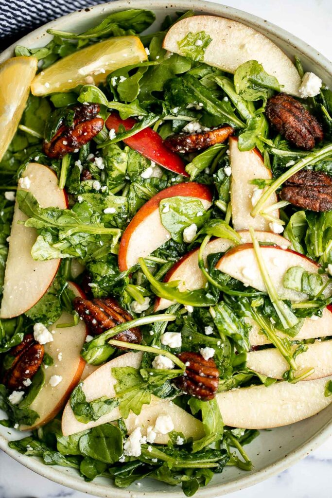 Arugula salad with apple and pecan is a quick and easy fall salad made with fresh seasonal ingredients in just minutes. Perfect for a holiday dinner table. | aheadofthyme.com