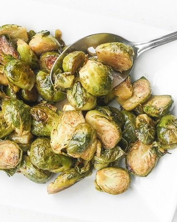 Easy Roasted Brussels Sprouts: Tender and caramelized, easy roasted brussels sprouts tossed in balsamic vinegar and honey is a classic household favourite to serve on your holiday table.   aheadofthyme.com