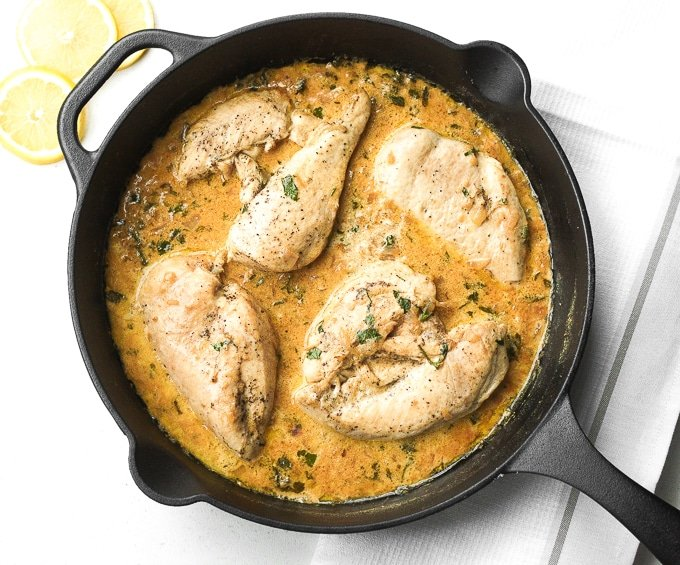 The Perfect Skillet Chicken with Lemon Garlic Sauce: An exquisite meal made in 30 minutes? Serve the perfect skillet chicken with lemon garlic sauce for dinner tonight! | aheadofthyme.com