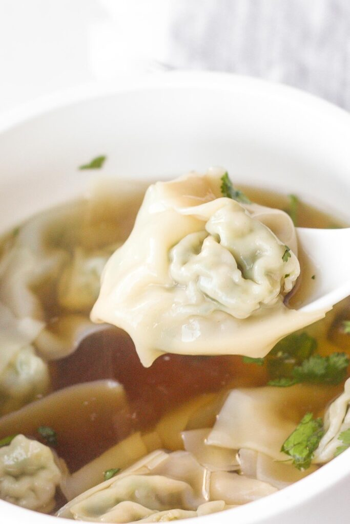 Learn how to make easy 10-minute wonton soup, using just a handful of delicious ingredients. | aheadofthyme.com