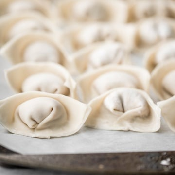 Learn how to make homemade chicken and cilantro wontons to celebrate Chinese new year with this easy to follow recipe and instructions on how to fold wontons. | aheadofthyme.com