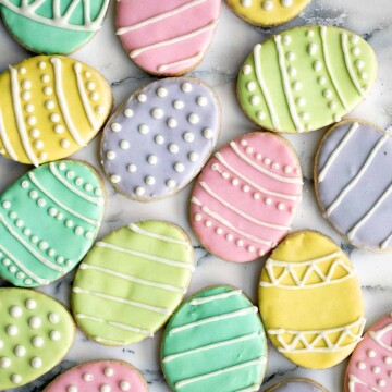 Cute, delicious, and easy-to-make Easter egg sugar cookies with royal icing are the perfect treat to make this Easter. Crisp outside and soft inside. | aheadofthyme.com