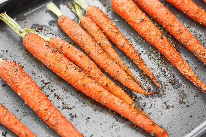 Sweet and flavourful easy garlic and herb roasted carrots is the perfect side dish to your holiday (Easter) or everyday dinner! | aheadofthyme.com