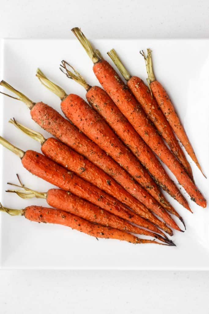 Sweet and flavourful easy garlic and herb roasted carrots is the perfect side dish to your holiday dinner or your everyday weeknight dinner. | aheadofthyme.com