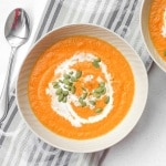 Smooth, rich and velvety roasted carrot and ginger soup is full of flavour, healthy, and super easy to make. | aheadofthyme.com