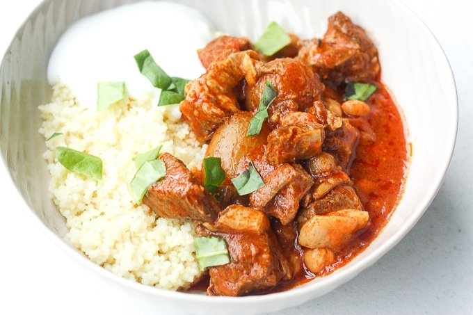 A bowl of flavourful and tender, juicy slow cooker Moroccan lamb stew served over a bowl of couscous is the ultimate Middle Eastern comfort food. | aheadofthyme.com