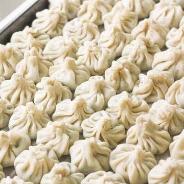 Easy to make chicken and shrimp dumpings can be steamed, boiled or fried and served with a side of soy sauce for dipping!   aheadofthyme.com