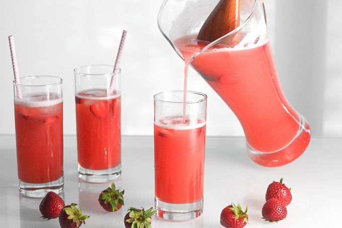 Complete your summer party, barbecue or picnic with a sweet, refreshing pitcher of sparkling strawberry lemonade, made with real fruit! | aheadofthyme.com