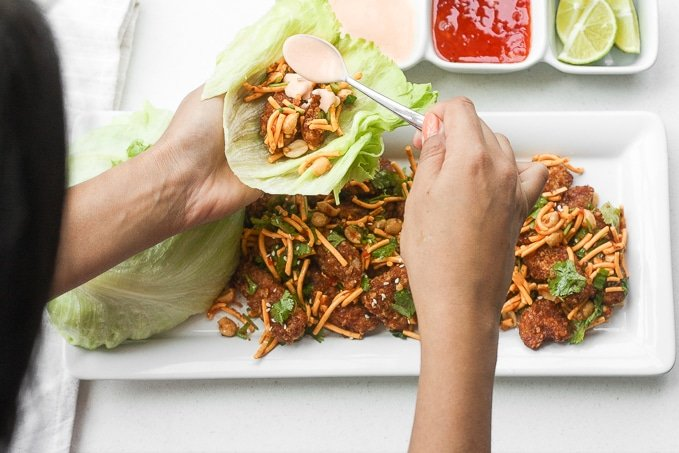 Spice it up and make copycat Szechuan chickenlettuce wraps with spicy mayo from the comfort of your own home with this easy to follow recipe. Plus, it is healthier than the original! | aheadofthyme.com