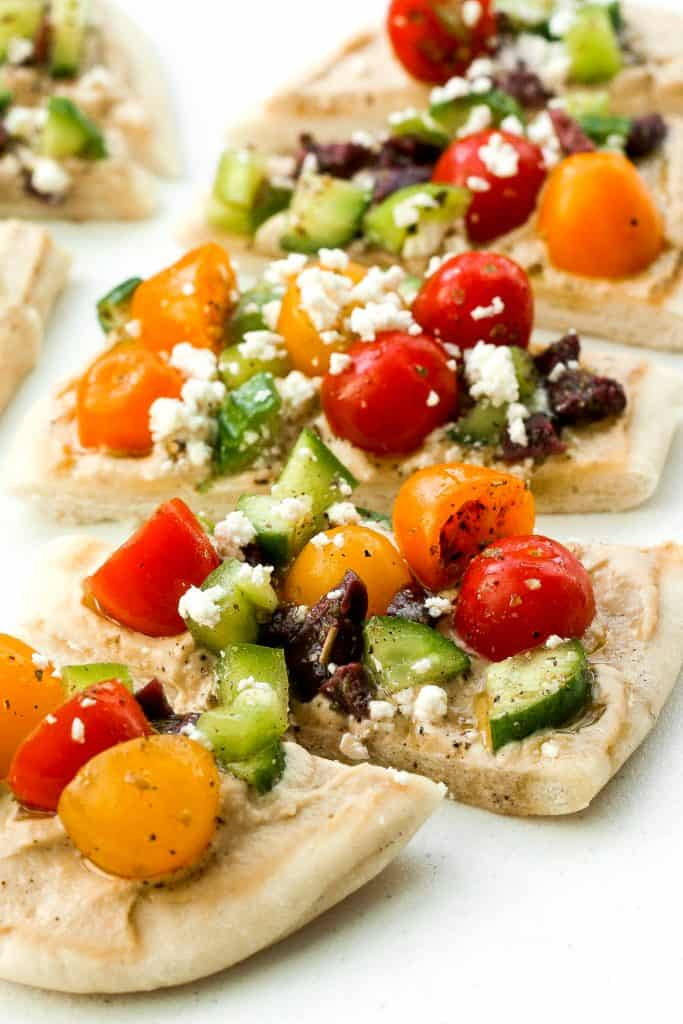 This bright and colourful Greek salad hummus flatbread is perfect as an appetizer or a healthy lunch or snack. | aheadofthyme.com