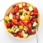 Celebrate summer with this go to, simple and colourful summer fruit salad! Just toss a handful of fruits together in a honey lemon dressing and dig in! | aheadofthyme.com