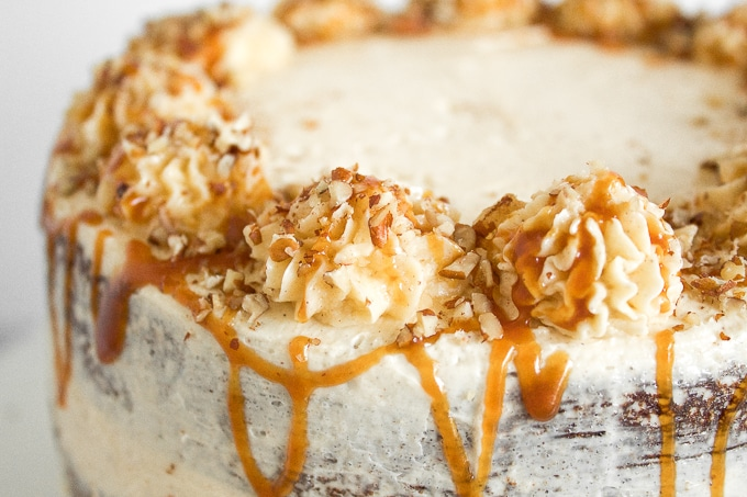 Apple cardamom cake with caramel pecan butter frosting is the perfect fall cake and is made by combining all your favourite fall flavours together. | aheadofthyme.com