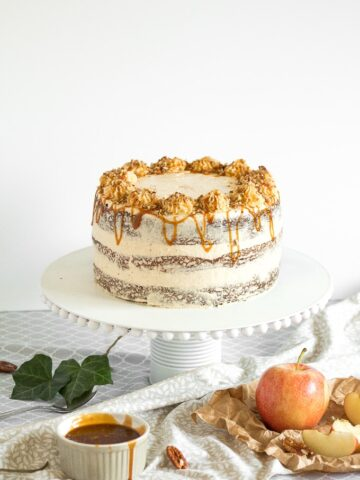 Apple cardamom cake with caramel pecan butter frosting is the perfect fall cake and is made by combining all your favourite fall flavours together.   aheadofthyme.com