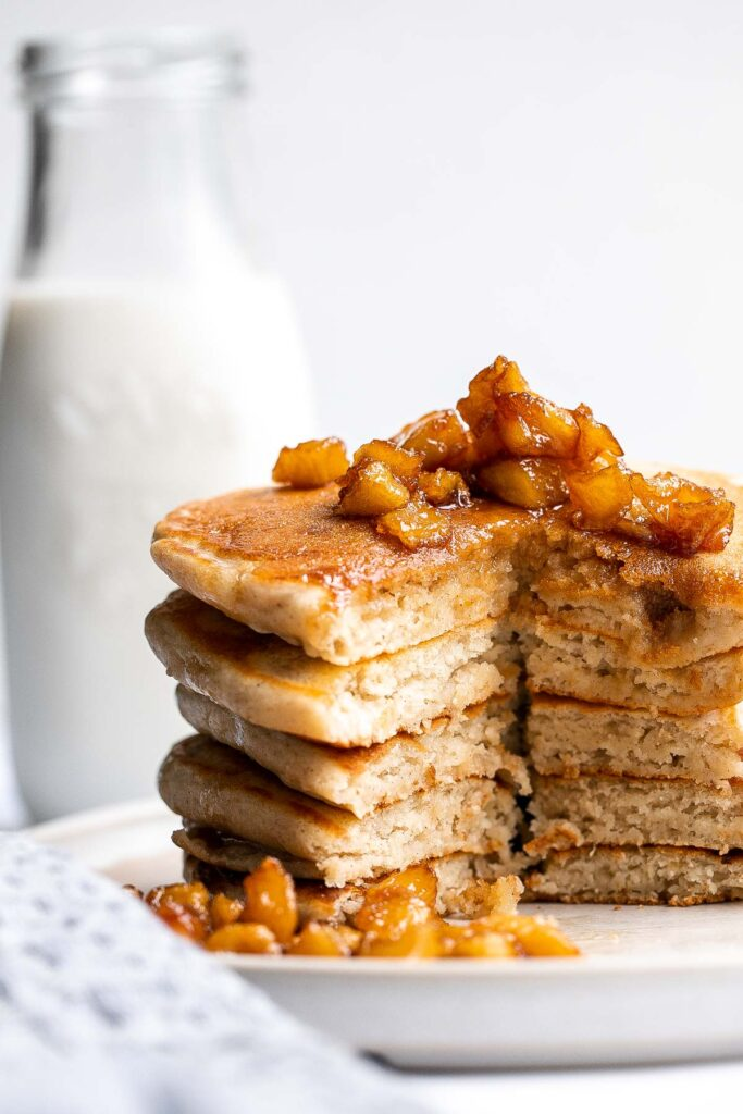 Soft fluffy applesauce pancakes is the best fall breakfast, loaded with leftover applesauce, hint of cinnamon, and a delicious caramel apple topping. | aheadofthyme.com