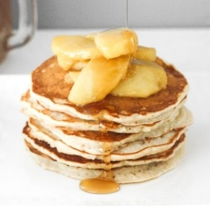 There is no better way to use up leftover applesauce than by making fluffy applesauce pancakes with caramel apple topping! It is the perfect fall breakfast! | aheadofthyme.com