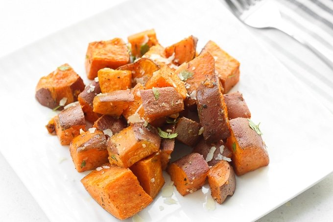 Crispy on the outside and soft and tender on the inside, these flavourful, herb-roasted sweet potatoes are the perfect addition to your holiday table. | aheadofthyme.com