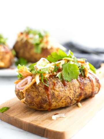 Try this gorgeous combination of BBQ chicken, scallions, cilantro and gruyere for an explosion of flavour in loaded BBQ chicken stuffed baked potatoes! | aheadofthyme.com