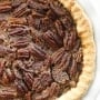 Classic pecan pie is an essential Thanksgiving dessert! Try this easy to follow recipe to get that flaky crust, smooth custard filling and pecan topping. | aheadofthyme.com