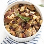 Cranberry walnut bread paired with sautéed apples, onions and rosemary is exactly what your holiday table needs! Hello cranberry walnut apple stuffing! | aheadofthyme.com