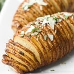 Hasselback potatoes with garlic herb butter are perfectly crispy on the outside and tender and buttery on the inside, infused with garlic and rosemary. | aheadofthyme.com