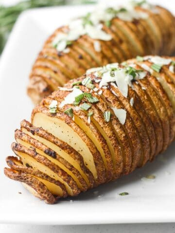 Hasselback potatoes with garlic herb butter are perfectly crispy on the outside and tender and buttery on the inside, infused with garlic and rosemary.   aheadofthyme.com