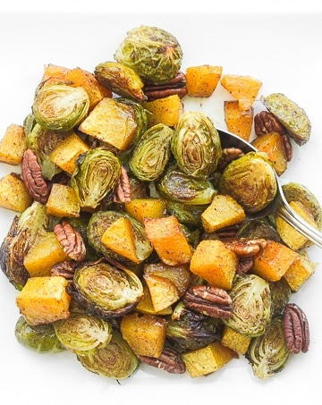 Take the stress out of entertaining with this easy, one-pan maple roasted brussels sprouts and butternut squash side dish, filled with flavour in every bite.   aheadofthyme.com