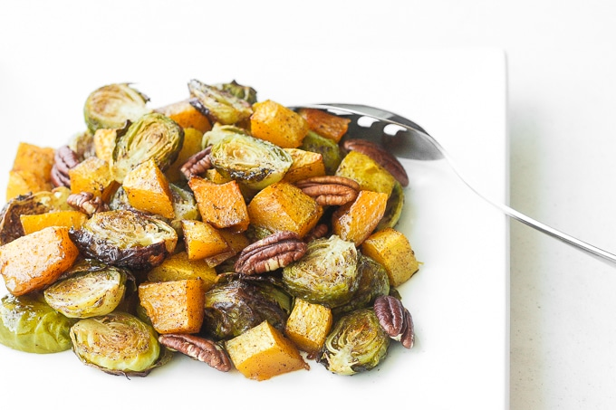 Take the stress out of entertaining with this easy, one-pan maple roasted brussels sprouts and butternut squash side dish, filled with flavour in every bite. | aheadofthyme.com